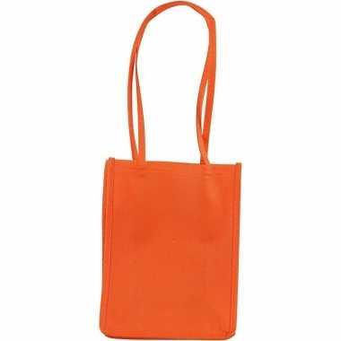 Kleine oranje tassen met hengels