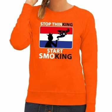 Stop thinking start smoking sweater oranje dames