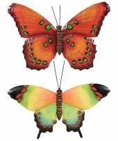 Set van 2x stuks tuindecoratie muur wand vlinders van metaal in oranje en groen tinten 48 x 30 cm